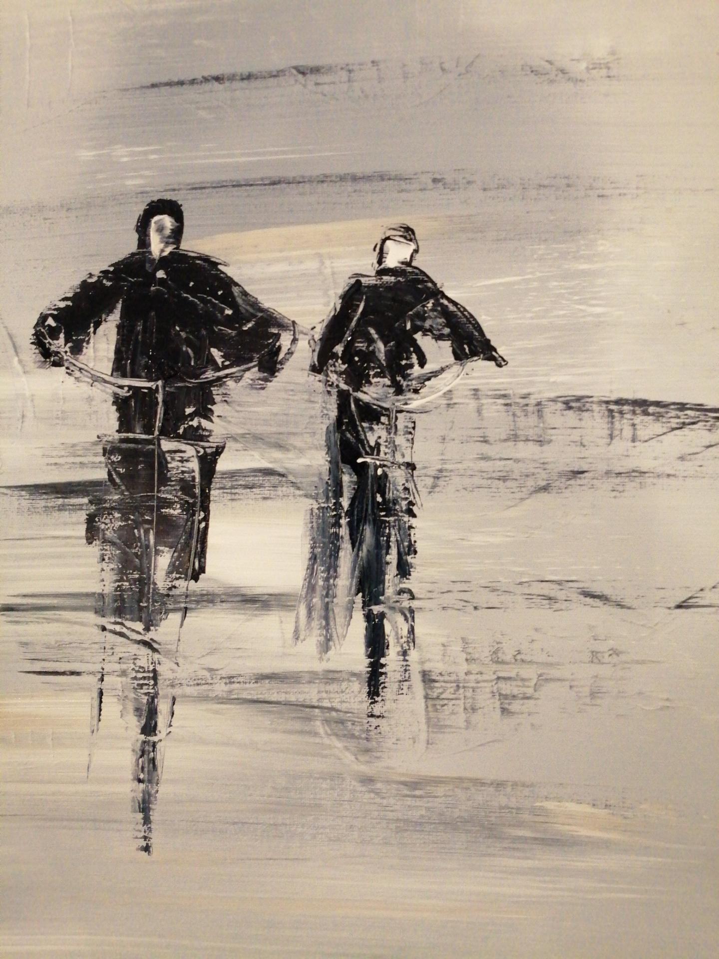 deux cyclistes sur la plage