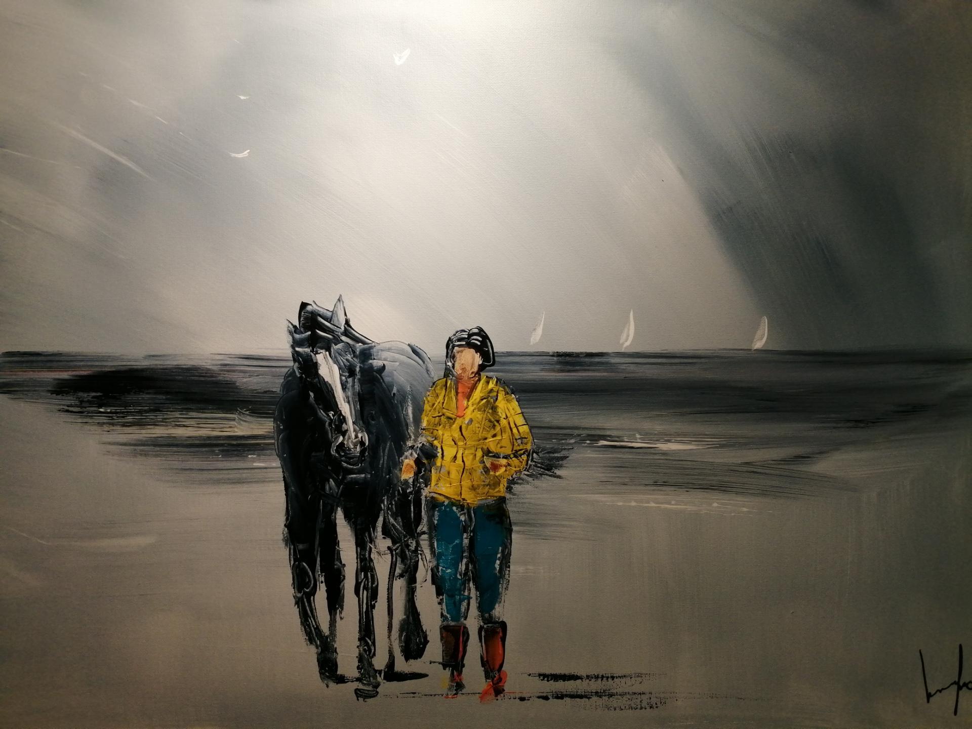 la balade avec le cheval sur la plage